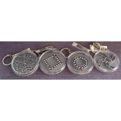 set of 4 dexterity puzzle round / key chains