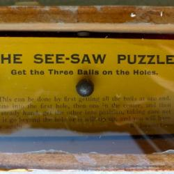 The See-Saw Puzzle